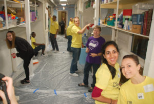 EY staff giving the Family Focus Highland Park center a fresh coat of paint.